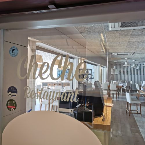 interior of the restaurant cheche from castelldefels with a sticker of The Blue Dolphin Store